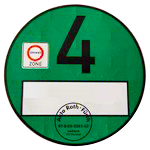 zieloną plakietkę